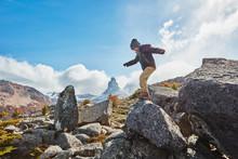 Chile, Cerro Castillo, Boy Jumping From Rock In Mountainscape