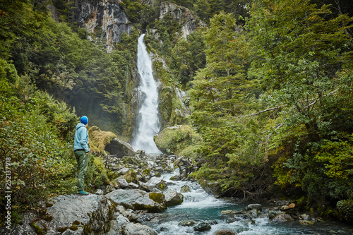 Chile, Laguna San Rafael National Park, woman admiring Las Cascadas waterfall - 252137918