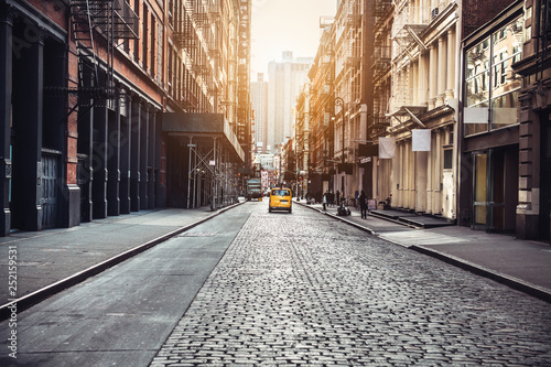 Tuinposter New York TAXI New York City Manhattan SoHo street at sunset time background