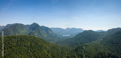 Aerial view of a beautiful Canadian Landscape during a sunny summer day. Taken in Kenyon Lake, located near Mission, East of Vancouver, BC, Canada.