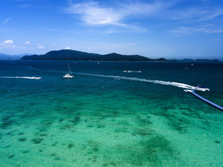 Aerial of cabin cruiser and speedboath on the big ocean in Andaman at koh He or Coral island, Phuket, Thailand