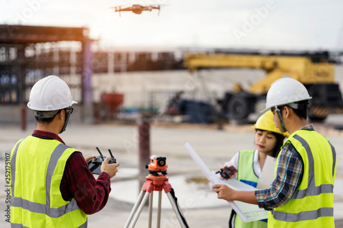 civil engineering flying drone over construction site survey for
