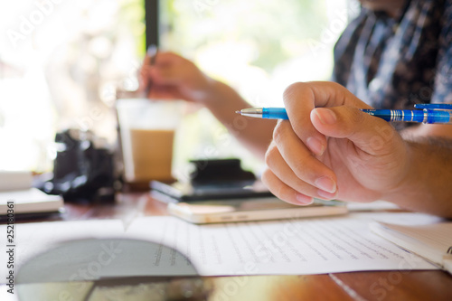 Fototapety, obrazy: business man writing something on paper, meeting business, teamwork, closeup hand writing