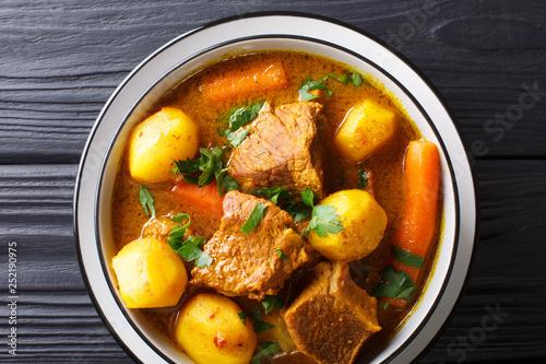 Fototapeta Namibia Potjiekos traditional lamb dish with vegetables close-up in a bowl. Horizontal top view obraz