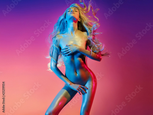 Foto op Canvas womenART Nude sexy blonde in colorful light. Night club dance