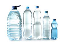 Different Bottles Of Clean Water On White Background