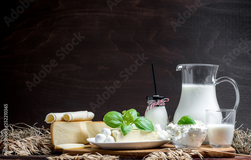 Fotografía Many fresh dairy products in front of a rustic vintage background