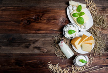 Many Fresh Dairy Products In Front Of A Rustic Vintage Background
