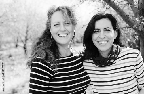 Fotografie, Obraz Portrait of two smiling real mature women outdoor