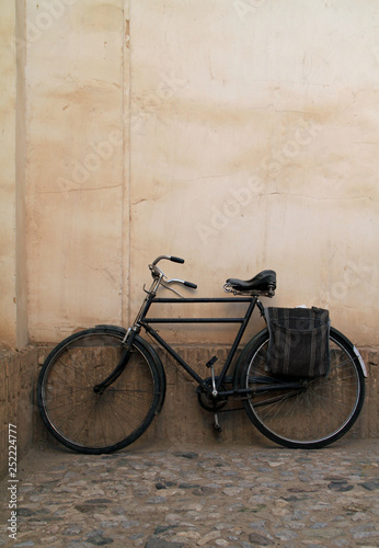 Recess Fitting Bicycle Old bicycle leaning against a wall