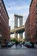 Manhattan Bridge with the Empire State Building through the Arches, seen from Washington Street in Brooklyn, New York, United States of America, North America