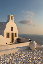 View Of Traditional White Washed Church At Sunset In Oia, Santorini, Cyclades, Aegean Islands, Greek Islands, Greece