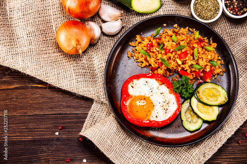 Fototapety, obrazy: Fried egg, groats and vegetables on wooden table
