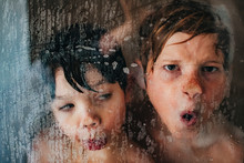 Young Boys Making Silly Faces In The Shower