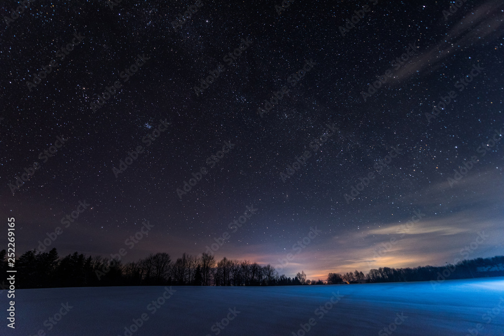 Fototapeta dark sky full of shiny stars in carpathian mountains in winter at night