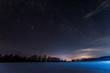 Leinwandbild Motiv dark sky full of shiny stars in carpathian mountains in winter at night