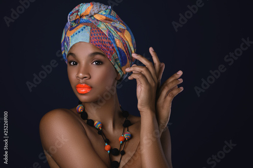 Fotografie, Obraz  African woman with a colorful shawl on her head