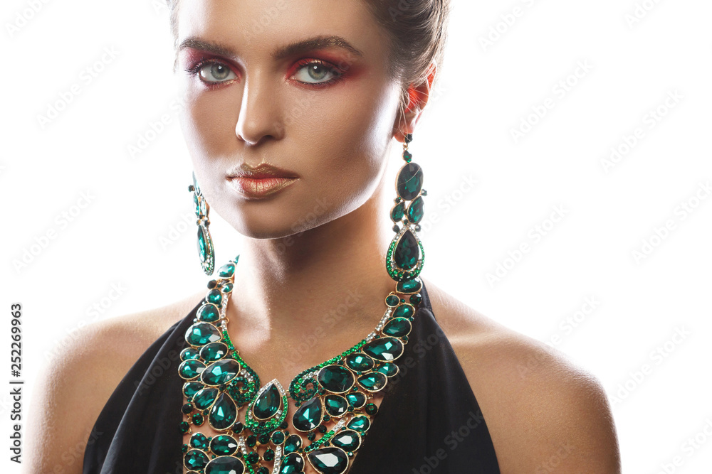 Fototapeta Sexy woman wearing big beautiful necklace and earrings with a lot of gems