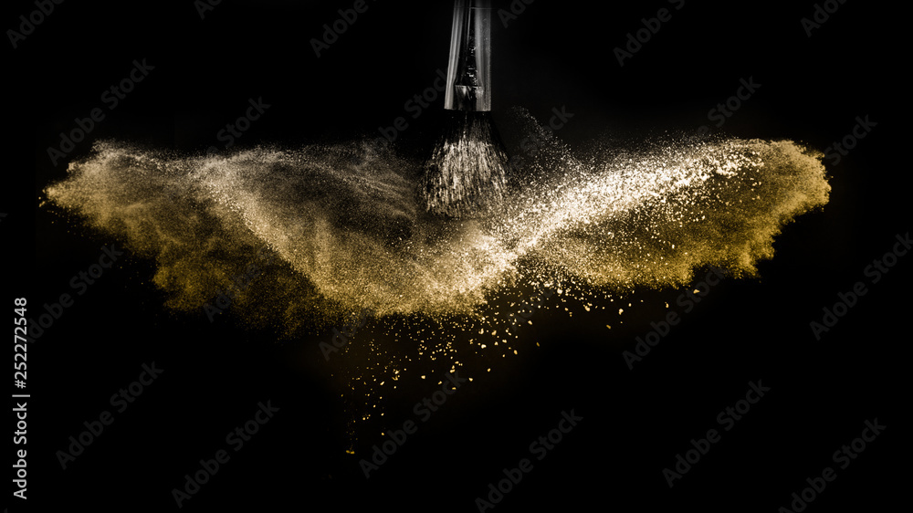 Fototapety, obrazy: Cosmetic brush with golden cosmetic powder spreading for makeup artist and graphic design in black background, look like a luxury mood.