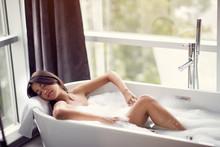 Relaxing In Bath- Woman In Bath With Foam.