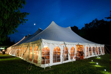 A Wedding Tent At Night With B...