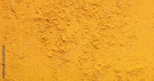 Yellow tirmeric powder texture, natural condiment background