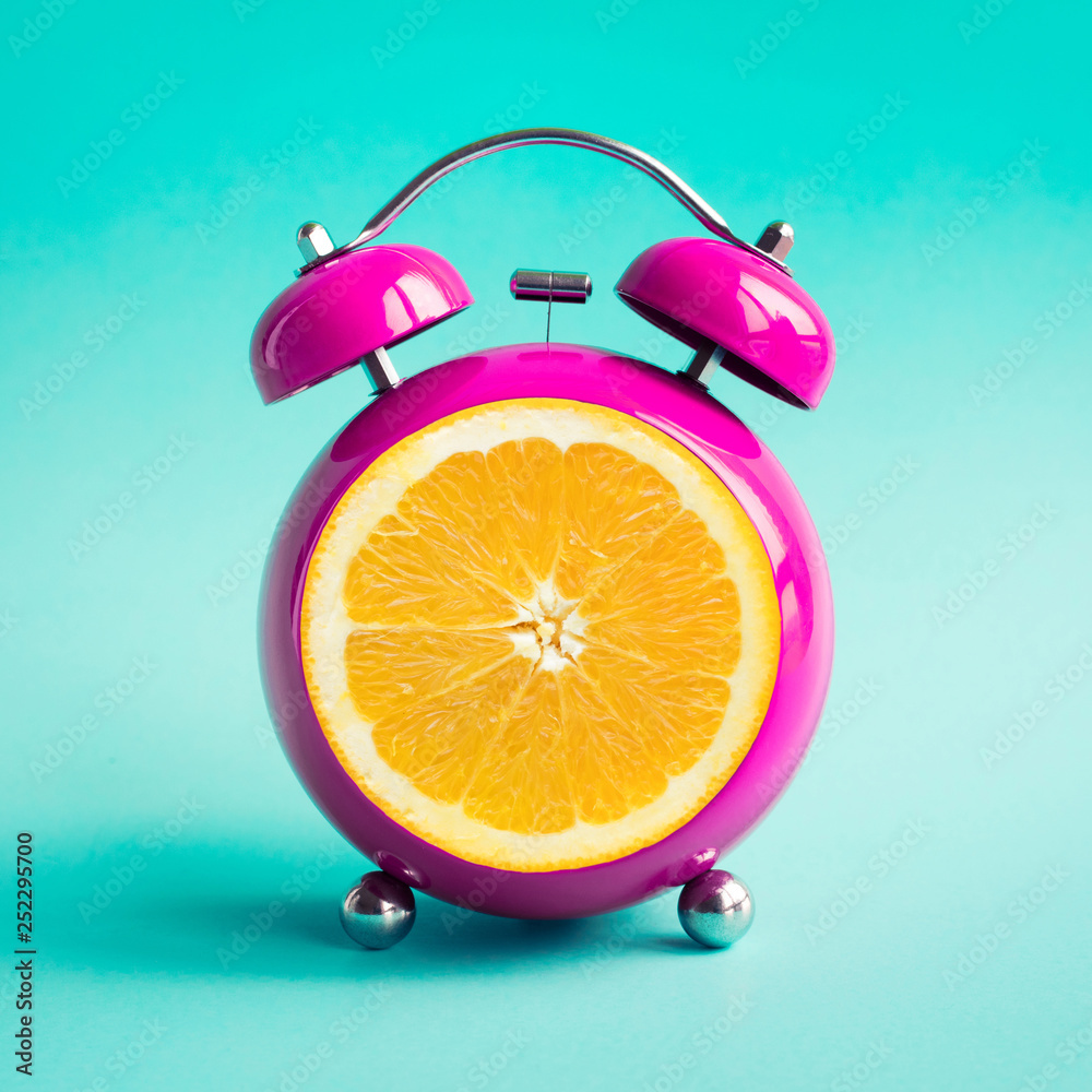 Fototapety, obrazy: Summer time concepts with orange alarm clock on blue pastel background.