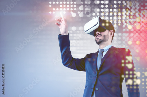 Fotografia, Obraz  Businessman in VR glasses purple digital interface
