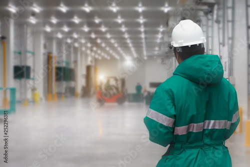 Fotografie, Obraz Staff worker control transporting goods in loading of the freezing warehouse