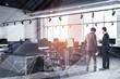 People in industrial style office corner