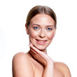 canvas print picture - Beauty Portrait. Beautiful Spa Woman Touching her Face. Perfect Fresh Skin. Isolated on White Background. Pure Beauty Model. Youth and Skin Care Concept