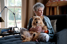 Woman Holds Her Cairn Terrier
