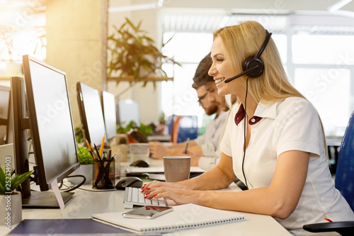 Business woman working at call center office