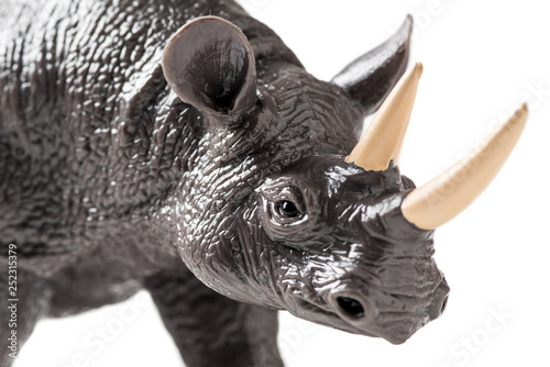 Fotografija  Rhino plastic figurine on white background