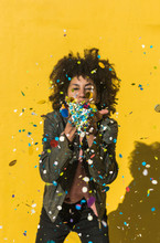 Black Woman With Afro Hair Throwing Confetti To Celebrate A Very Special Day