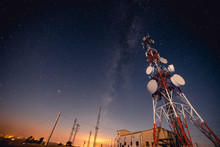 From Below Tall Modern Radio Tower Located Against Majestic Starry Sky At Wonderful Night
