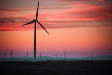 From Below Row Of Wind Generators And Amazing Pink Heaven At Sunset In France