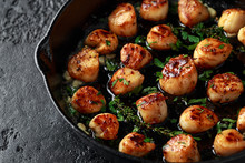 Scallops Seared In Garlic And Parsley Butter Served In Cast Iron Skillet