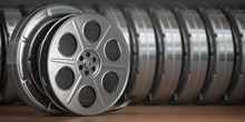 Video, Cinema, Movie, Multimedia Concept. A Row Of Vintage Film Reel Or  Film Spools With Filmstrip