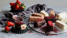 Chocolate And Strawberry Cakes Near Bows With Ingredients