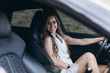 Luxury professional fashion model with new sport car outdoors. Fashion, transport, luxury concept