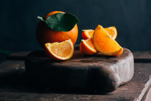 Fresh Cut Oranges On Dark Mood...