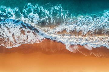FototapetaAerial view of sea waves and sandy beach