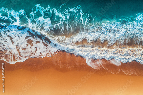 Aerial view of sea waves and sandy beach Canvas Print