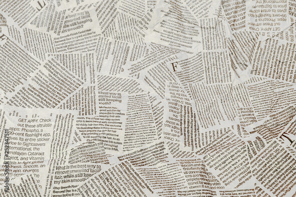Fototapeta Black and white repeating torn newspaper background. Continuous pattern left, right, up and down