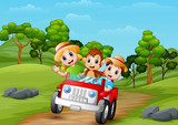 Happy children and monkey riding a red car on the road to forest