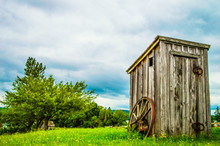 Old Wooden Outhouse In A Field