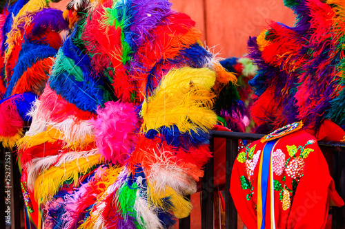 Fotografering  a colorful mexican ornament made with ostrich feathers in bright colors, huehue,