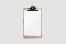 A Wooden Clipboard With A Blank Piece Of Paper .