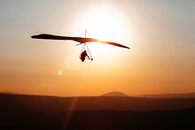 Hang-glider  Flight In Sky In Sunset Time Over The .Galilean Hills, Mevo Hama, Israel